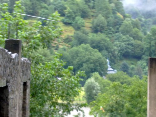 A quaint mosque across the river in Indian Kashmir